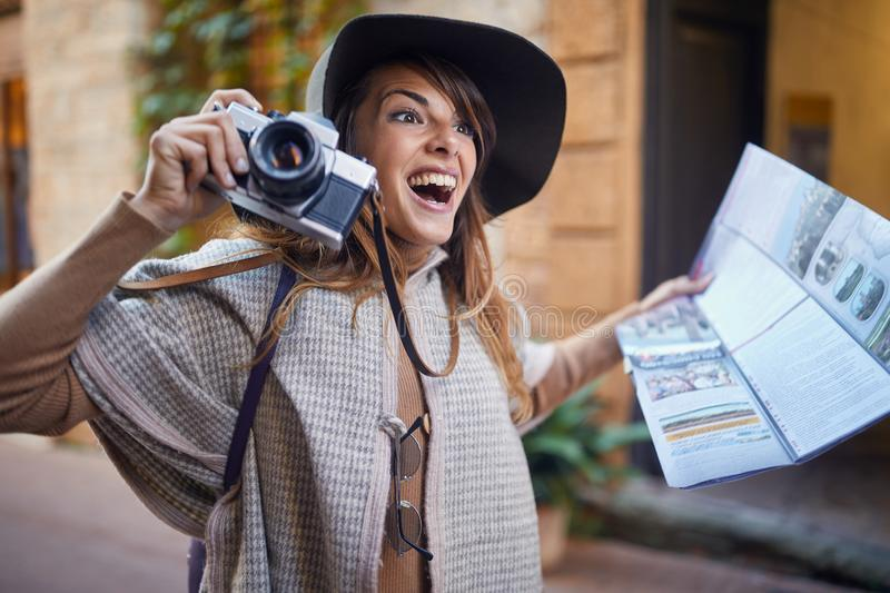Tourist Woman With Camera Taking Photos Of Beautiful Location royalty free stock images