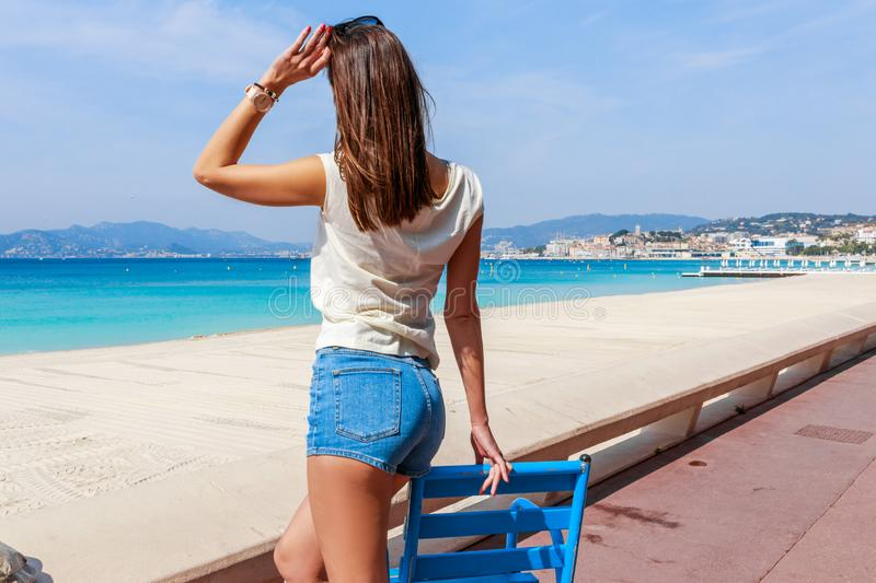 Tourist woman in Cannes, Cote d`Azur, France, South Europe. Nice city and luxury resort French riviera. Famous tourist destinatio. N with nice beach and royalty free stock image