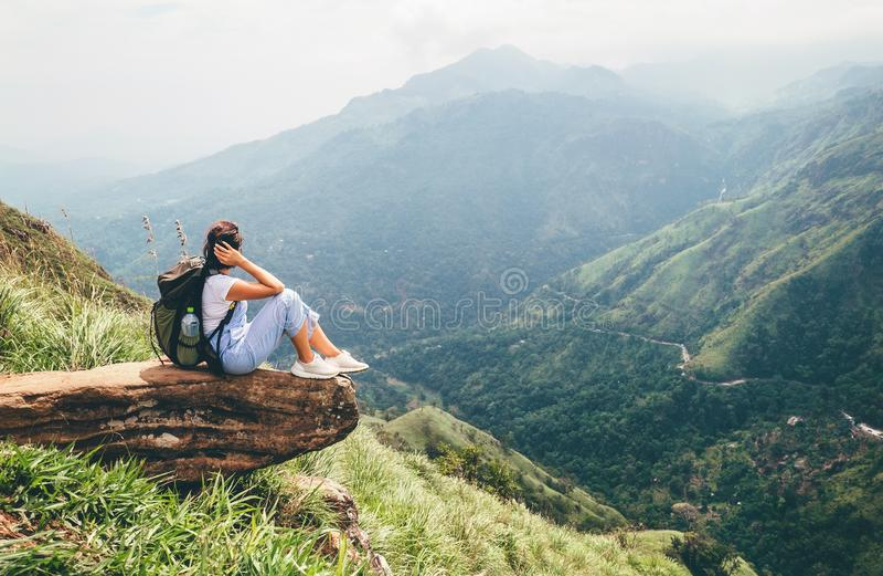 Tourist woman enjoy with beautiful view on mountains in Ella, Sri Lanka, Little Adam Peak stock photo