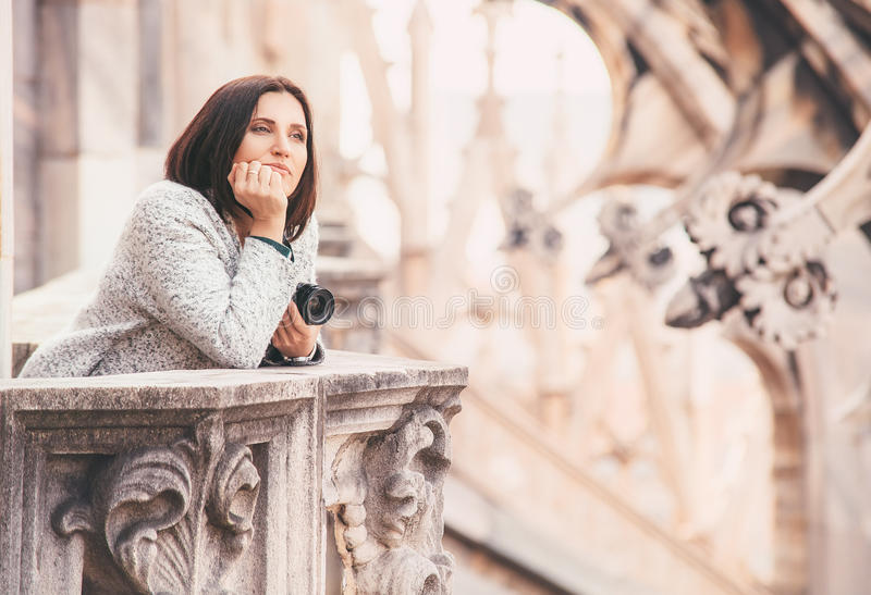 Tourist woman enjoy with calm atmosphere on the roof of Milano C. Athedral Duomo stock photos