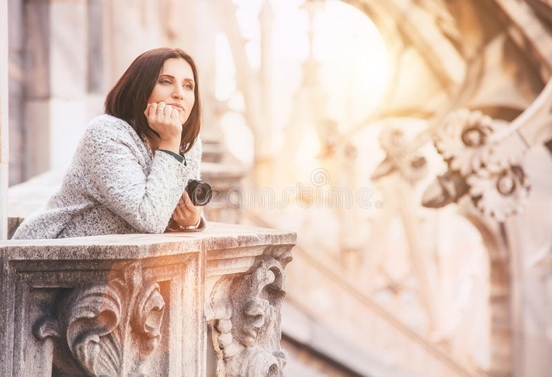 Tourist woman enjoy with calm atmosphere on the roof of Milano C. Athedral Duomo royalty free stock photography