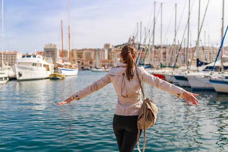 Tourist woman in French historical city Marseille and Mediterranean sea coast. Marseille is the biggest port in France, South. Europe. Famous large city and stock photos