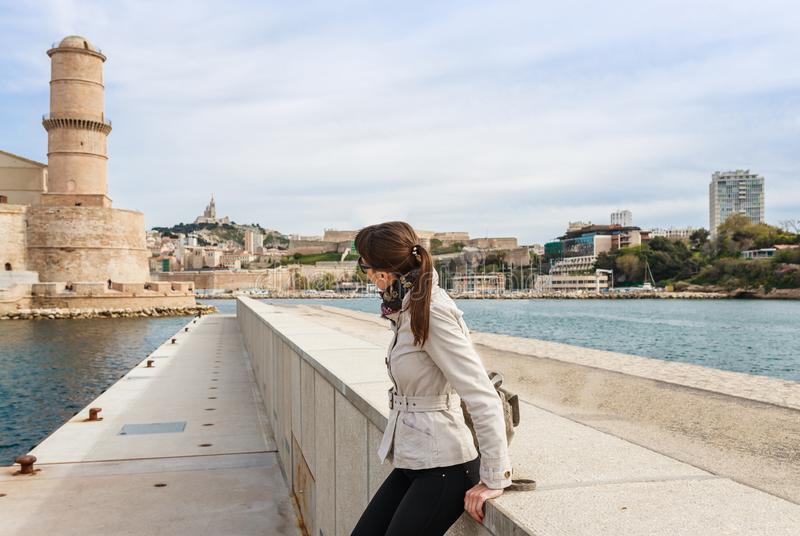 Tourist woman in French historical city Marseille and Mediterranean sea coast. Marseille is the biggest port in France, South. Europe. Famous large city and royalty free stock photography