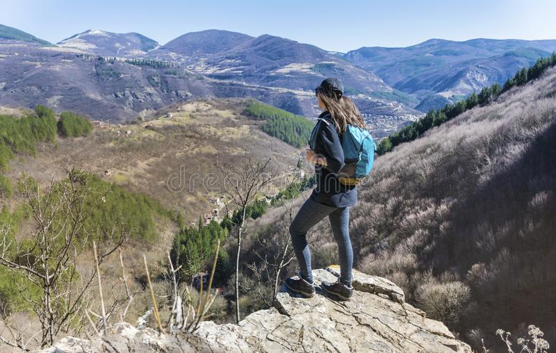 Tourist Woman in a High Mountain. Happy woman relaxing in a high mountain stock image