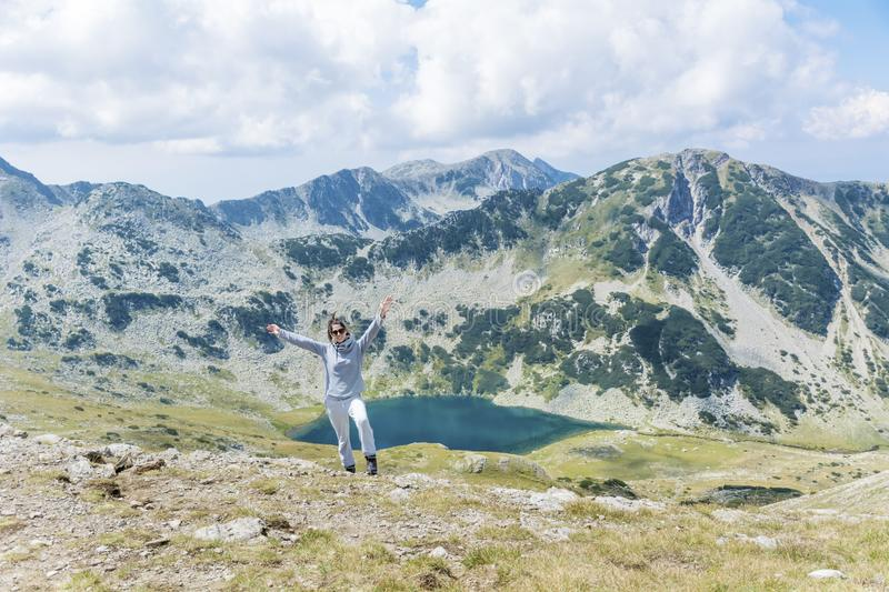 Tourist Woman in a High Mountain. Happy woman in Pirin mountain in the summer royalty free stock photography