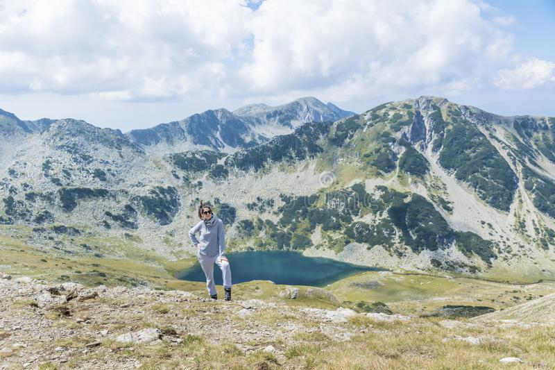 Tourist Woman in a High Mountain. Happy woman in Pirin mountain in the summer stock photography