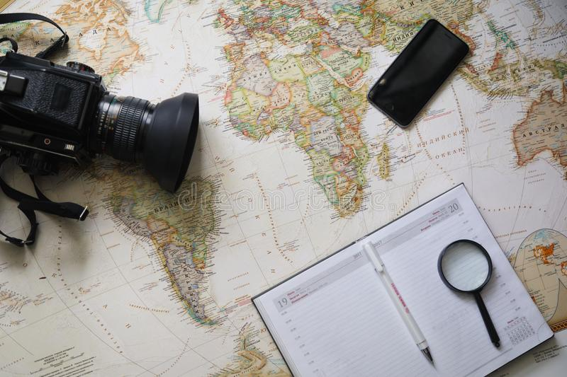 Tourist man looking at world map planning travel adventure royalty free stock image