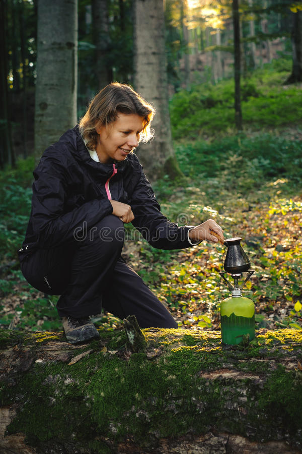 Download Tourist Woman Making Fresh Coffee In The Nature Stock Photo - Image of filter, morning: 83702234