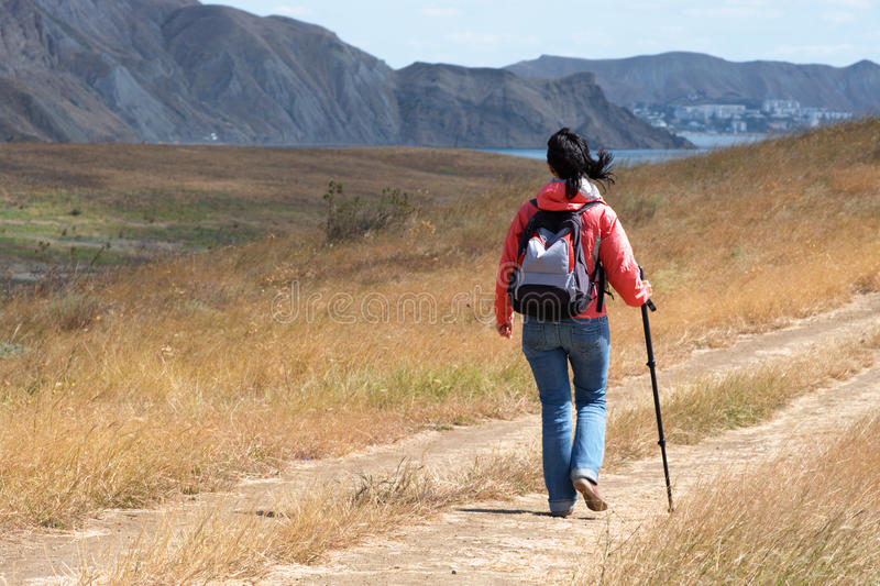 Download Tourist woman in mountains stock image. Image of adventure - 16421815