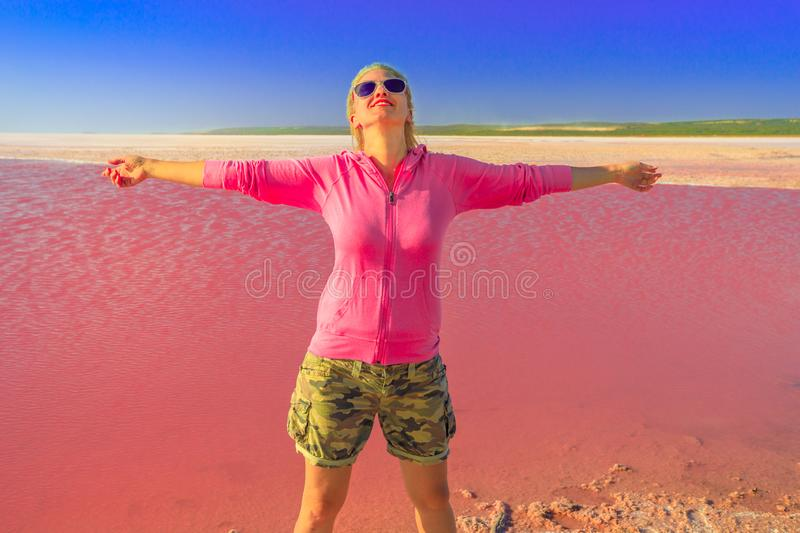 Tourist woman at Pink Lake stock images