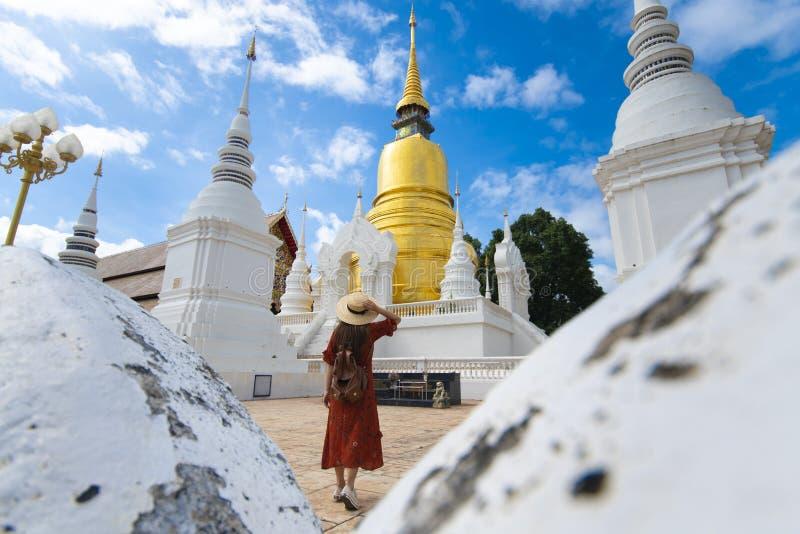 Tourist woman is sightseeing in Wat Suan Dok in Chiangmai stock photo