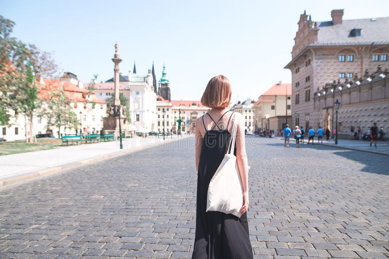 . Tourist woman strolls along the streets of an old city stock photo