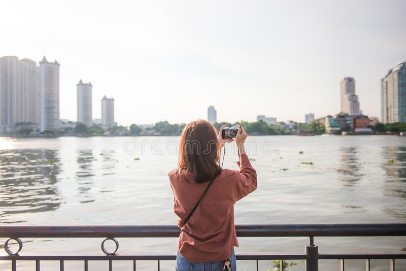 Tourist woman taking photo picture in bangkok, thailand. royalty free stock images