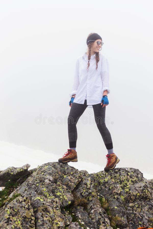 Tourist woman walking on rocks. royalty free stock photo