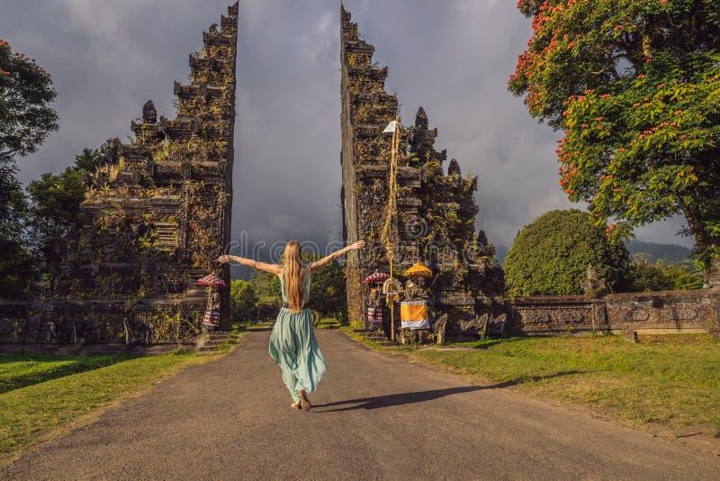Tourist woman walking through Traditional Balinese Hindu gate Candi Bentar close to Bedugul, Bratan lake Bali island stock images