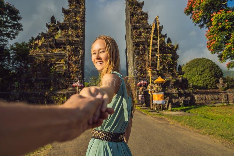 Tourist woman walking through Traditional Balinese Hindu gate Candi Bentar close to Bedugul, Bratan lake Bali island stock photography