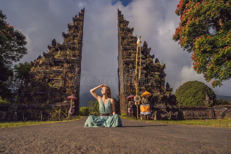 Tourist woman walking through Traditional Balinese Hindu gate Candi Bentar close to Bedugul, Bratan lake Bali island stock image