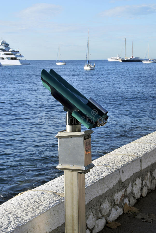 Touristic binocular. S in the coast. optical instrument to magnify the views stock image
