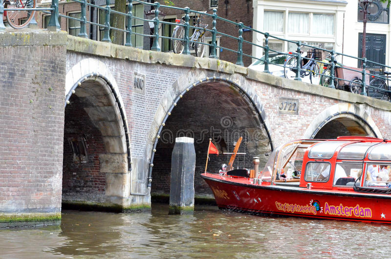Touristic boat in Amsterdam stock photography