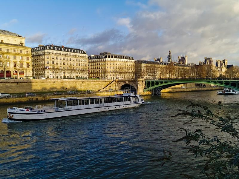 Touristic boat in the Seine stock images