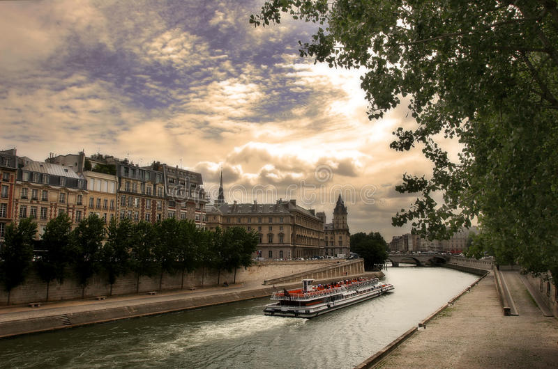 Touristic boat on Seine river in Paris, France. royalty free stock photography
