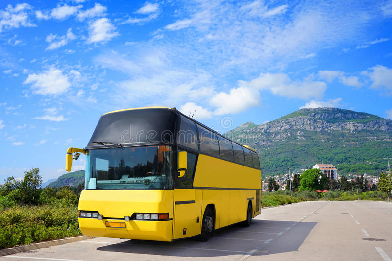 Touristic bus on the parking. Empty touristic bus is standing on the parking near the mountain royalty free stock photos
