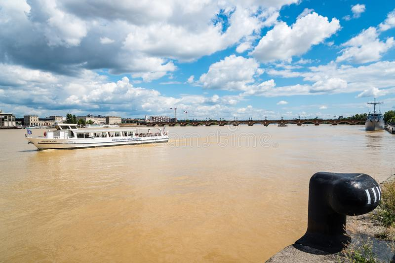 Touristic ferry sailing on River Garonne in Bordeaux royalty free stock photo