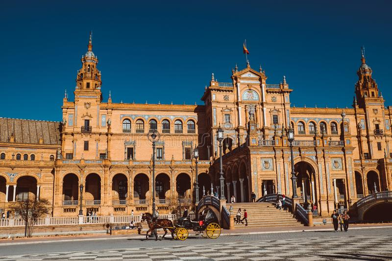 Touristic horse carriages and central building at Plaza de Espana. Seville, Spain stock photography