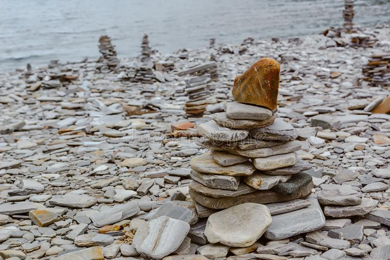 Touristic pyramid balanced stack of stones at the beach. In the way to Nordkapp, Norway royalty free stock photos