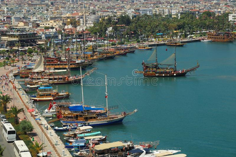 Touristic sailboats setting off to the Mediterranean sea in the ancient port of Alanya city. Antalya, Turkey. Touristic sailboats setting off to the stock images