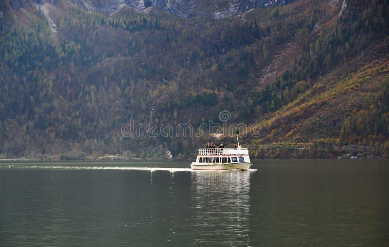 Touristic ship on Hallstatt Lake, Austria. Hallstatt, Austria - Oct 25, 2018. Touristic ship on Hallstatt Lake, Austria. Hallstatt Austria is a charming lakeside royalty free stock photography