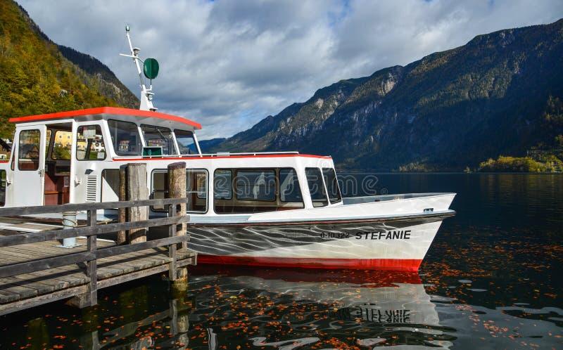 Touristic ship on Hallstatt Lake, Austria. Hallstatt, Austria - Oct 25, 2018. Touristic ship on Hallstatt Lake, Austria. Hallstatt Austria is a charming lakeside royalty free stock image