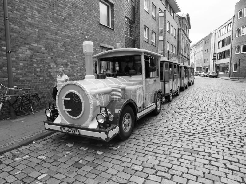 Touristic sightseeing train in Koeln, Germany, black and white. KOELN, GERMANY - CIRCA AUGUST 2019: touristic sightseeing train in black and white stock image