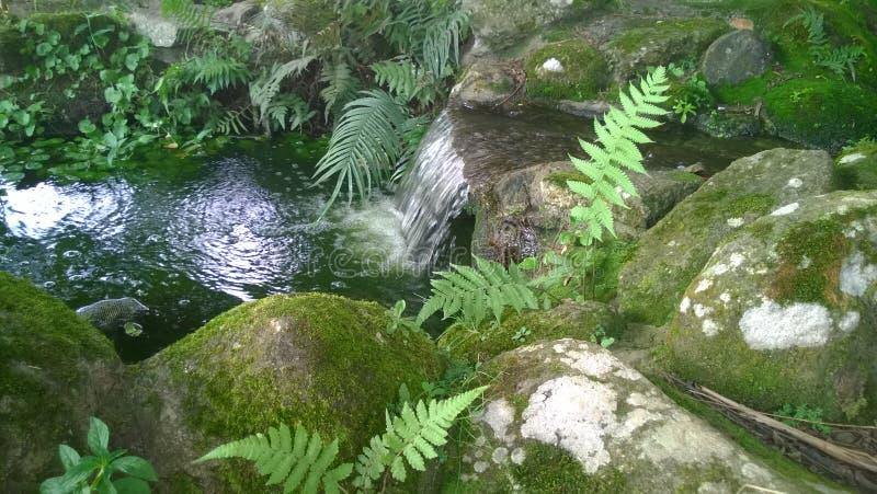 Touristic small artificial decorative waterfall stock photo