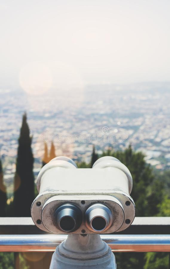 Touristic telescope look at the city with view of Barcelona Spain, close up old metal binoculars on background viewpoint overlook. Ing the mountain, hipster coin royalty free stock photos