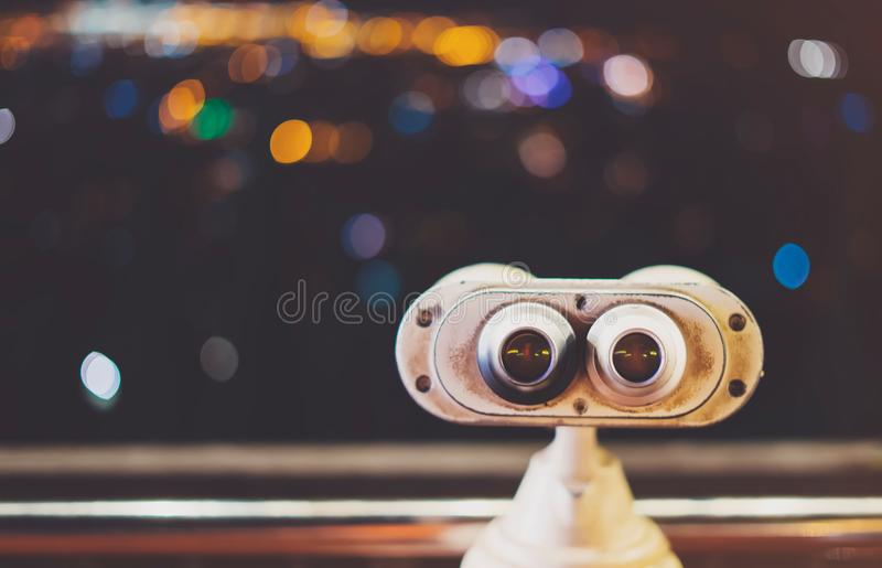 Touristic telescope look at city with view of Barcelona Spain, close up old metal binoculars on background viewpoint, hipster coin royalty free stock images