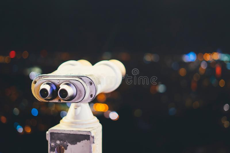 Touristic telescope look at city with view of Barcelona Spain, close up old metal binoculars on background viewpoint, hipster coin. Operated in panorama stock image