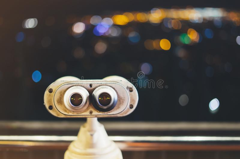 Touristic telescope look at city with view of Barcelona Spain, close up old metal binoculars on background viewpoint, hipster coin. Operated in panorama royalty free stock photography