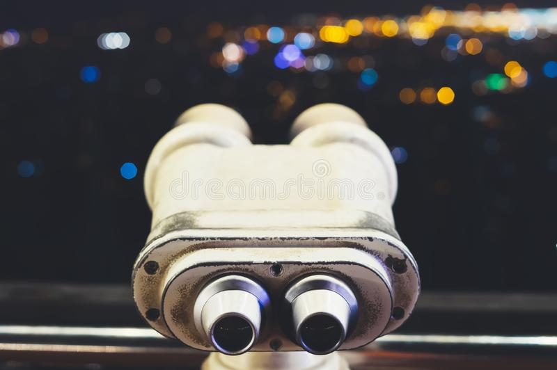 Touristic telescope look at city with view of Barcelona Spain, close up old metal binoculars on background viewpoint, hipster coin. Operated in panorama royalty free stock images