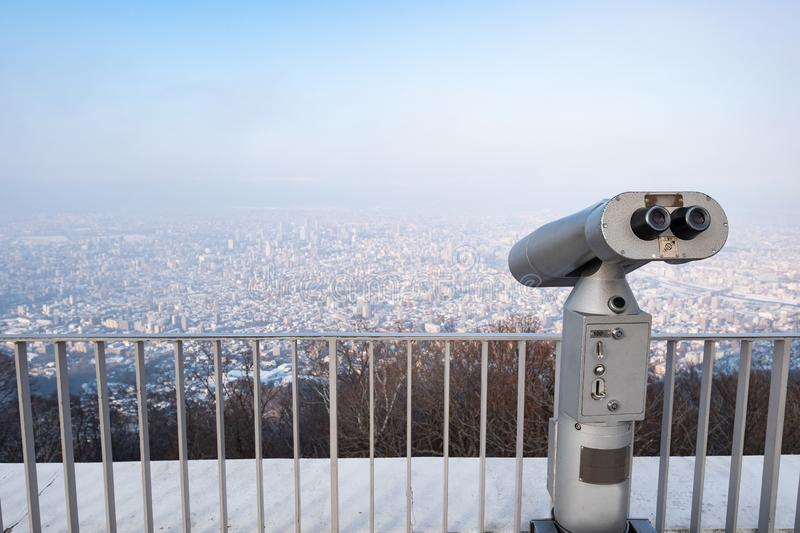 Touristic telescope look at city with view of Moiwa. Hokkaido Japan, on background viewpoint stock images