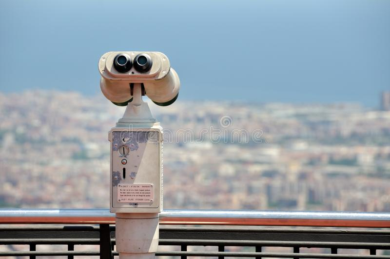 Touristic telescope with view of Barcelona. From Mountain Tibidabo stock photography