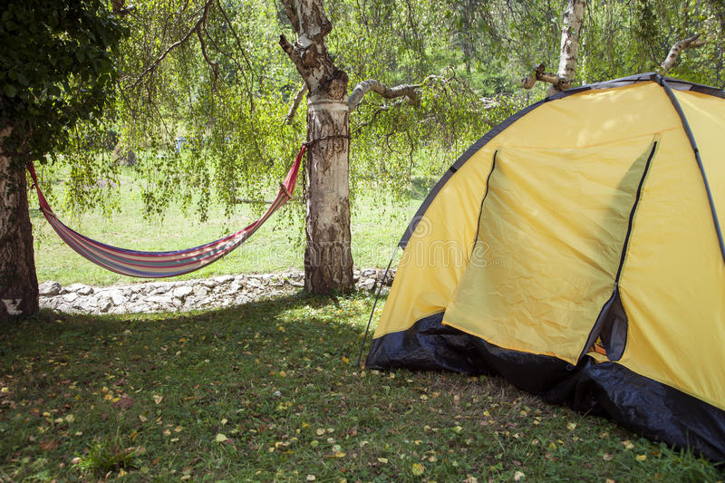 Touristic tent and hammock stock images
