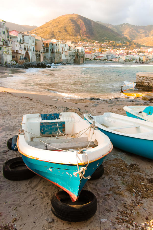 Touristic and vacation pearl of Sicily, small town of Cefalu, Si. Touristic and vacation pearl of Sicily, fishermen boats in small town of Cefalu, Sicily, south royalty free stock photo