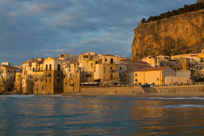 Touristic and vacation pearl of Sicily, small town of Cefalu, Si. Touristic and vacation pearl of Sicily, small town of Cefalu at sunrise, Sicily, south Italy royalty free stock images