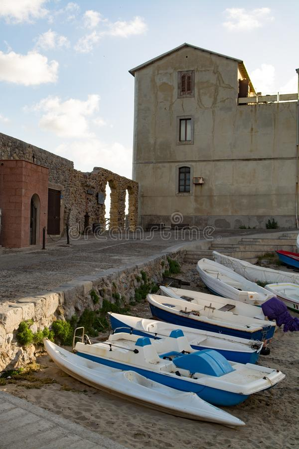 Touristic and vacation pearl of Sicily, small town of Cefalu, Si. Touristic and vacation pearl of Sicily, fishermen boats in small town of Cefalu, Sicily, south royalty free stock photography