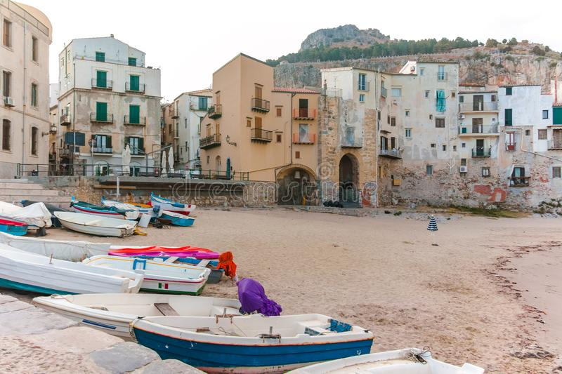 Touristic and vacation pearl of Sicily, small town of Cefalu, Si. Touristic and vacation pearl of Sicily, fishermen boats in small town of Cefalu, Sicily, south stock photo