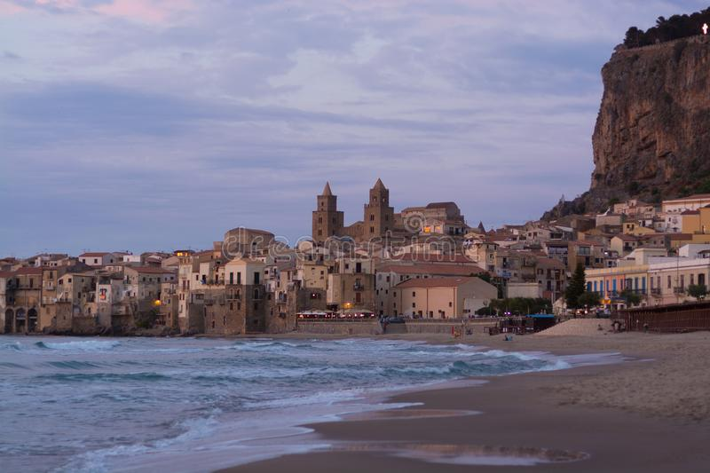 Touristic and vacation pearl of Sicily, small town of Cefalu, Si. Touristic and vacation pearl of Sicily, small town of Cefalu at sunrise, Sicily, south Italy royalty free stock photography