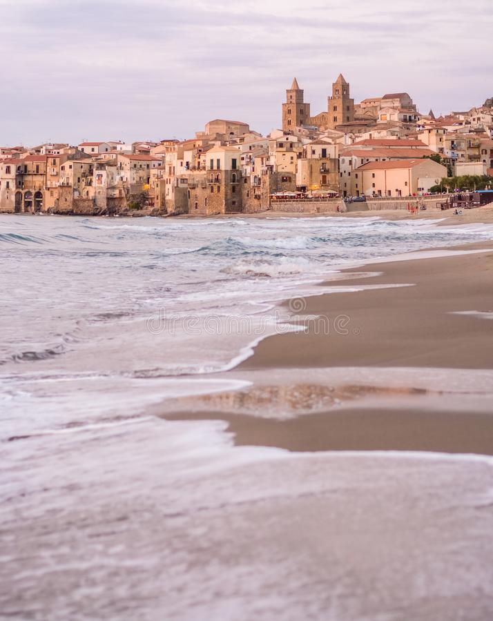Touristic and vacation pearl of Sicily, small town of Cefalu, Si. Touristic and vacation pearl of Sicily, small town of Cefalu at sunrise, Sicily, south Italy royalty free stock photo
