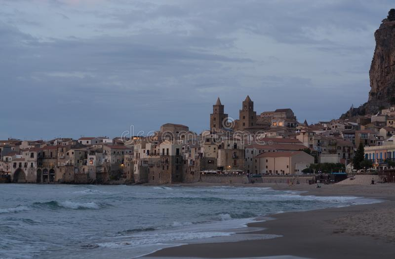 Touristic and vacation pearl of Sicily, small town of Cefalu, Si. Touristic and vacation pearl of Sicily, small town of Cefalu at sunrise, Sicily, south Italy royalty free stock photos