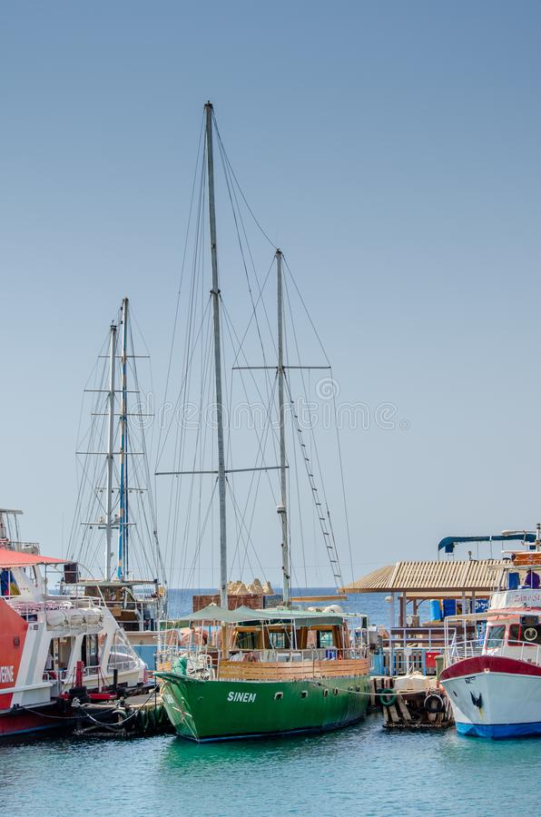 Touristic wooden sailing boats at the marina of Eilat, Red Sea. EILAT, ISRAEL - SEPTEMBER 24, 2012: Touristic wooden sailing boats at the marina of Eilat, Red royalty free stock photography